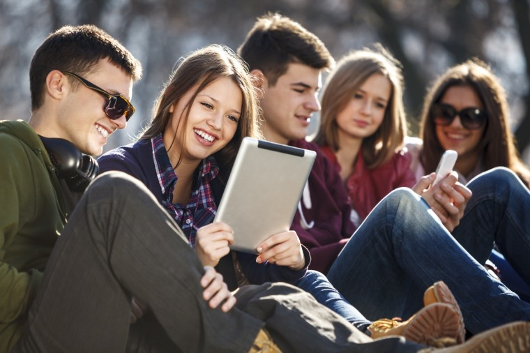 Young People Using Mobile Devices
